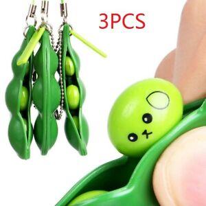 3X Lustige Squeeze Peas Bohnen Keychain Anti Stress Spielzeug Anhänger Gift TT