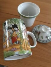 PRETTY CHINESE CUP WITH STRAINER AND LID....BEAUTIFULY DECORATED....