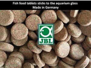 Fish food tablets sticks to the aquarium glass, food JBL for all types of fish