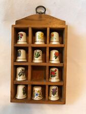 Vintage 11 thimbles with solid wood holder- Missing One Flower Thimble