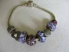 Pretty bracelet with pink, mauve & silver beads