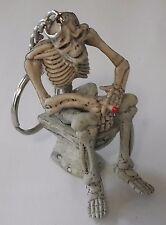 Rubber Keychain Keyring Skeleton sitting on Dunny Skull Harley Goth