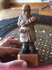 Vintage Wood Carved Toriart Pediatrician Baby in Pocket Pouring Medicine Bottle
