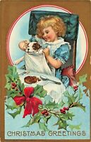 YOUNG GIRL WITH DOG IN HER APRON~CHRISTMAS GREETINGS EMBOSSED 1910s POSTCARD