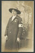 Old Postcard RP. Nurse In Long Coat & Hat, Chest & Arm & Hat Badges. Torrington.
