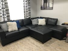 Black Leather Sectional Ottoman Included