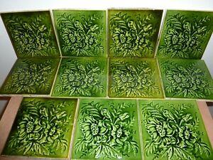 ELEVEN ANTIQUE 14.6 CM SQUARE GREEN GLAZED TILES WITH RELIEF FLOWER &LEAF DESIGN