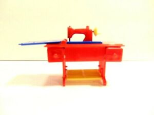 red and blue plastic doll house sewing machine;  Renwal No. 89, USA
