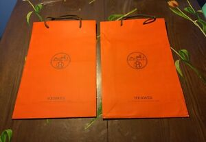 4 Preowned Designer Carrier Bags