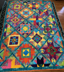 Handmade pieced quilt professionally quilted. Turquoise Batik 64x90