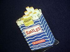 "VINTAGE CARDBOARD ADVERTISEMENT: ""SMILES"" CIGARETTES, OAKLAND TOBACCO CO."