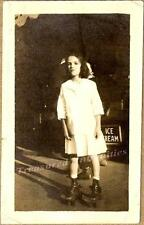 1920s Young Girl Wears Roller Skates Skating on Sidewalk Ice Cream Parlor Photo