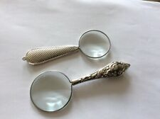 Two small vintage magnifying glasses