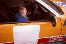 PHOTO  ANDY HEAT AGED 3 AT THE WHEEL OF RUSSELL BROOKES' ANDREWS HEAT FOR HIRE F