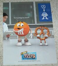 2010 ad page - M&M's chocolate pretzel candies CUTE Orange print Advert Clipping