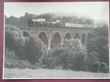 PHOTO  8 X 5.5 IN BRITTANIA CLASS LOCO & ANOTHER GOING OVER VIADUCT
