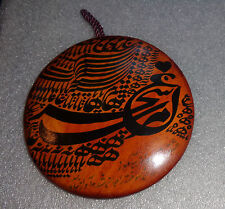 Painted Islamic love bird script on leather button