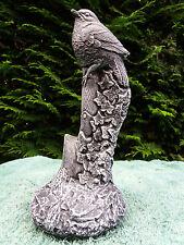 Stone/concrete garden statue ornament of a bird on a spade