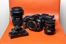 Sony Alpha a99 II DSLR with Zeiss 16-35mm f/2.8, Sony 50mm f/1.4, batteries, etc