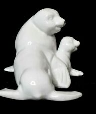 White Seal and Baby Figurine Sea Lion Got on bottom 3 1/8 in tall x 4 1/4 wide