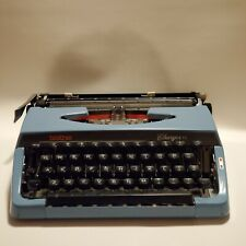BROTHER CHARGER 11  BLUE PORTABLE TYPEWRITER WITH BLACK CASE. VINTAGE