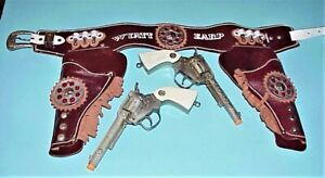 VINTAGE 1950's TWIN WYATT EARP GUNS W/ WHITE GRIPS, & BEJEWELED LEATHER HOLSTERS
