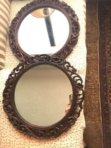 Pair of Anglo-Indian, raj or British colonial round carved mirrors