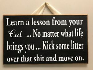 Learn lesson from CAT no matter life brings u kick litter over sh!t move on sign