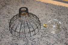 BLACK METAL CEILING LIGHT SHADE AND OVERSIZED BULB.
