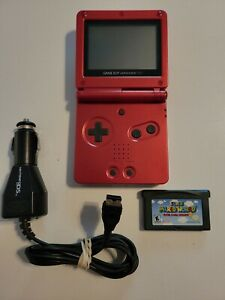 Nintendo Gameboy Advance SP RED AGS-001 w/ Super Mario Advance 2 & Car Charger