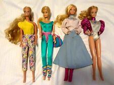 Barbie Dolls - lot of four dolls.