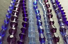 MIXED LOT GLASS FACETED BEAD STRANDS (9) COBALT PURPLEBICONE ROUND CUBE OVAL