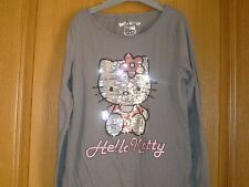 t shirt Hello Kitty comme neuf 12 ans