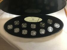 2000  Twelve Silver  Canada 25 Cent coins in a beautiful Black  Clam shell case.