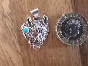 Silver Wolf Head Pendant with turquoise crafted by a member of the Navajo Nation