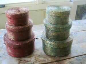 2 SETS OF ROUND NESTING BOXES - RED AND GREEN PAINTED TWINE WITH GOLD ACCENTS