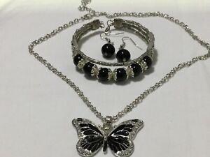 Black Onyx Bracelet, Earrings + Black Enamel Butterfly Necklace.  UK.