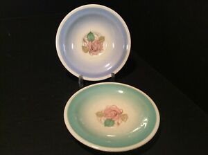 """SUSIE COOPER, A PAIR OF BLUE AND GREEN """"PATRICIA ROSE"""" PATTERN COFFEE SAUCERS"""