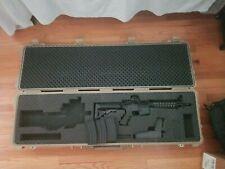 Colt Replica Full auto electric M4A1 Carbine with Pelican case for storage.