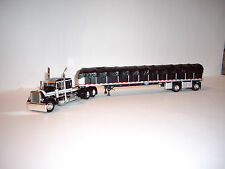 DCP 1/64 BLACK WITH WHITE STRIPES 379 PETERBILT WITH SPREAD AXLE COVERED WAGON
