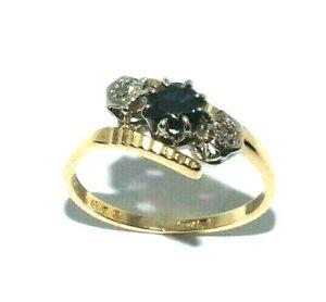 Ladies 18ct yellow gold twist design ring set with a sapphire+diamonds UK size M