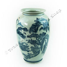 Blue & white ceramic willow design vase