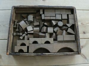 Architectural vintage wooden building blocks in a box