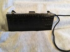 Black Clutch Purse, measures 7.5 x 4, Fake Snake Skin, Has a Strap,