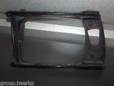 OEM 79-83 Toyota Corolla front driver headlight shroud trim cover assembly L