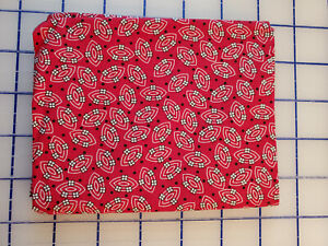 Aunt Grace 10th Ann. 2001 Fat Qtr Reproduction fabric Red football pattern.