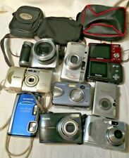 Lot Of 10 Digital Cameras  And 3 Cases.