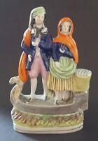 Staffordshire vintage Victorian antique fisherman & wife flatback figurine