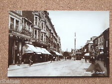 R&L Postcard, Queen Street Cardiff, Shops/Theatre/Cafe 1920's?