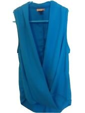 BODY CENTRAL Woman's Sleeveless Solid Blue Blouse/Top. Crisscross. Size Small